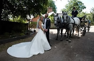 Bride and bridegroom posing for Essex wedding  photographer at Great Baddow Church Essex
